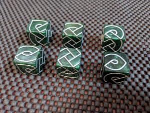 Here are six Knot Dice showing the different sides face up.