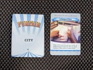 An example city card from Funfair a theme park building board game.