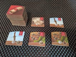 Examples of the quest tokens from Hall of Heroes for Raiders of the North Sea a Viking themed board game.