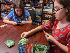 Kids enjoying the card game Fairy Season