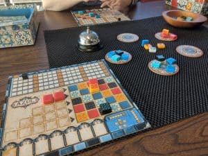 The board game Azul being played.