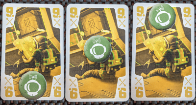 Using your communication tokens is key to winning a round of the cooperative trick-taking card game The Crew