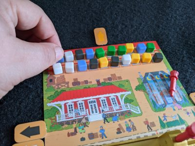 Loading cubes in the train game Rail Pass