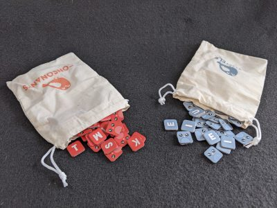 Bags of letter tiles from A Little Wordy from Exploding Kittens