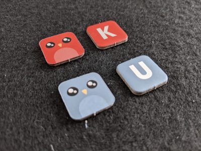 The letter tiles from A Little Wordy from Exploding Kittens