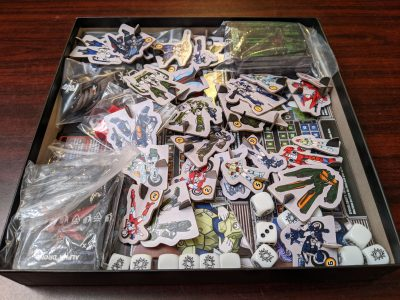 Fitting everything back in the box for Robotech: Invid Invasion
