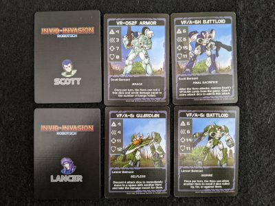Player cards from Robotech: Invid Invasion showing different Next Generation Mecha