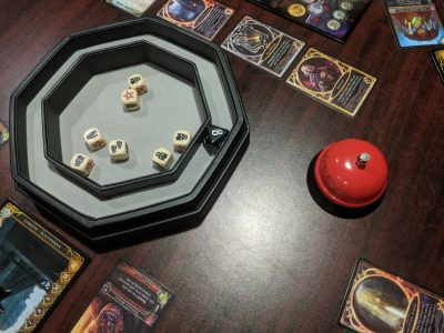 A staging area is one of the features to look for in a dice tray.