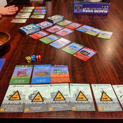 Playing Machi Koro another roll for resources card game.