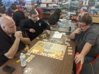 Hosting a board game tournament, with many tables of players.
