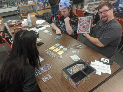 Playing a medium length game at a local board game tournament.