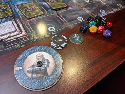 Playing Aventuria: Adventure Card Game with Life Wheel counters.