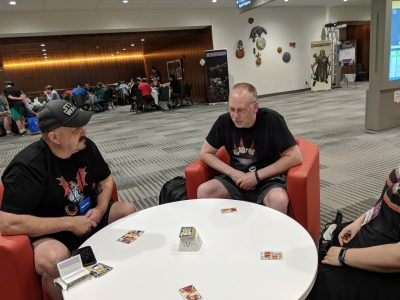 The Designer of Circle of Six teaching the game at Origins