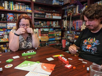 Two players trying to determine which scents they are smelling in a game of Aroma