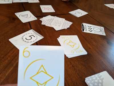 Circle of Six, a light card game on the table.