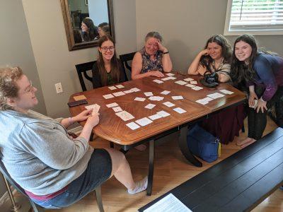 A family having fun playing Circle of Six
