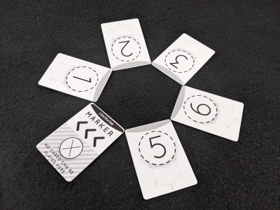 The circle of 6 is made out of circle cards in a game of Circle of Six