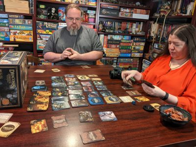 A three player game of Draconis Invasion taking place.