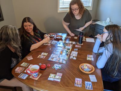 The entire family enjoying a game of Unfair with the ABDW expansion.