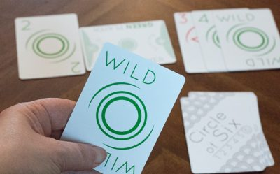 A green Wild card from Circle of Six