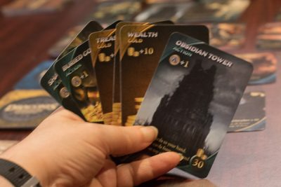 Lots of actions but no Defenders in this hand of cards for the boardgame Daconis Invasion