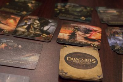 Close up of some of the card stacks from a game of Draconis Invasion