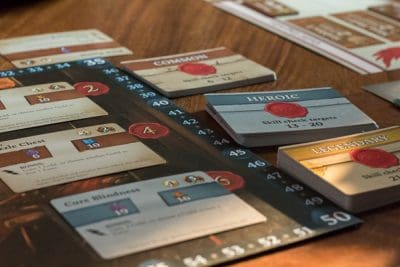 Guild Master, a board game where you send heroes to complete contracts.