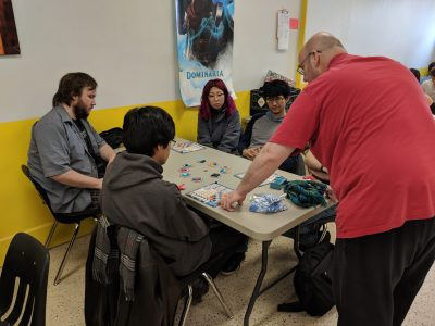 My friend Ross teaching players how to play Azul