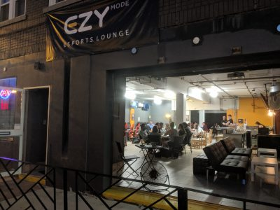 A shot of game night at EZY Mode from the outside looking in.