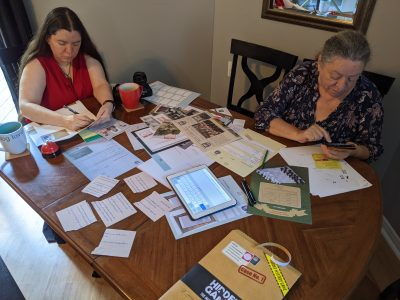 My wife and mother in law digging through evidence while playing Hidden Games Crime Scene.