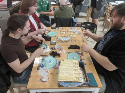 A group of three playing Quacks in public.