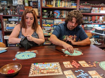 Kat and Tori learning to play The Quacks of Quedlinburg